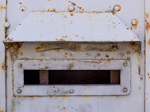 Rusty metal mailbox slot